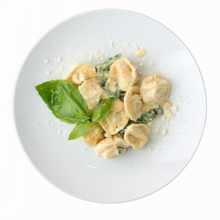 ravioli stuffed with chicken in a creamy sauce with spinach
