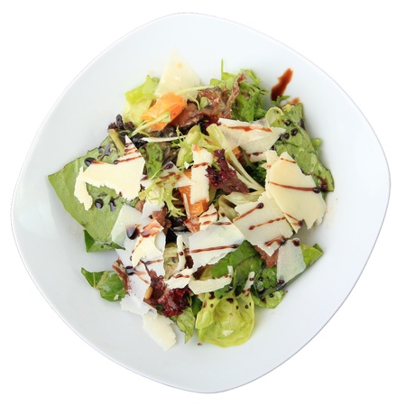 chicken salad: salad with chicken liver and orange honey dressing in white dish isolated on a white background. Top view.