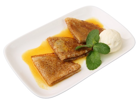 flapjacks: three pancakes with orange sauce, mint twig and scoop of vanilla ice cream in rectangular dish isolated on a white background Stock Photo