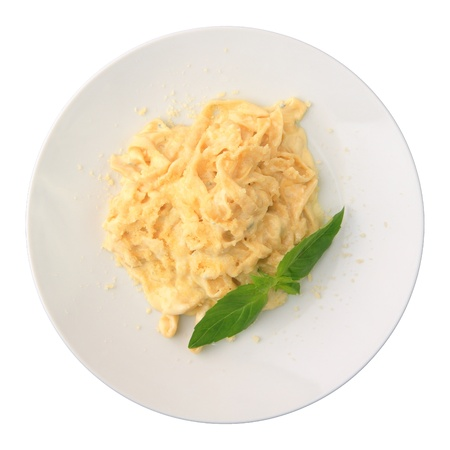 Pasta fettuccine with cheese on a white round dish isolated on a white background. Top view. photo