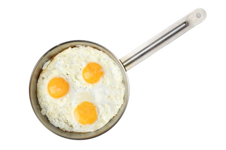 omelet: three fried eggs on stainless steel pan isolated on a white background