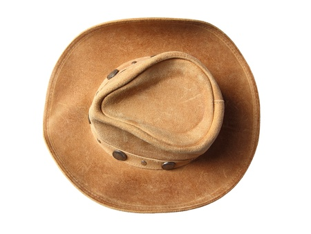 brown leather hat: Top view of beige cowboy hat, decorated of coins isolated on a white background