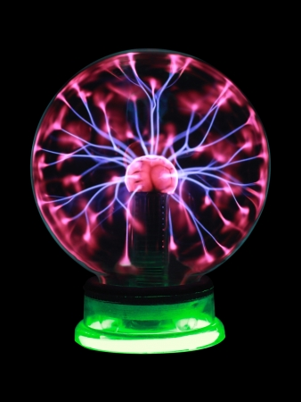 captivate: Plasma ball souvenir on green stand isolated on a black background