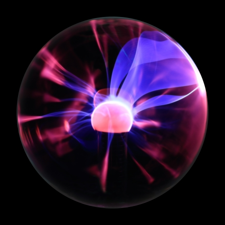 emanation: Plasma ball souvenir with magenta-blue flames isolated on a black background. Large blue flames directed to the right side. Stock Photo