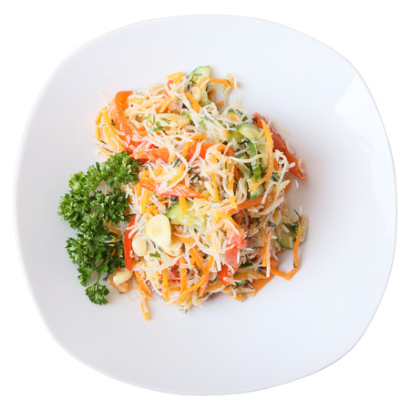 funchoza salad with rice noodles and vegetables on white dish . Top view. Stock Photo