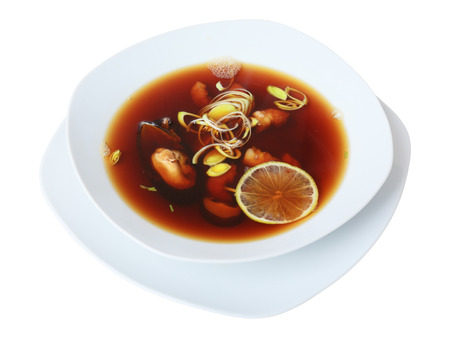 shiitake: suimono soup with mussels, shrimps and  shiitake mushrooms in white bowl isolated on white background