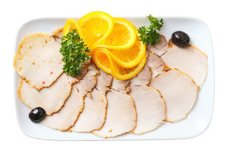 cold cuts: slices cold boiled pork on white rectangular plate isolated on a white background. Top view.