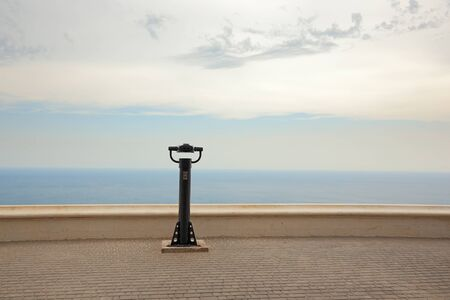 Black spotting scope pipe at cape fiolent observation deck. View to the Black sea.