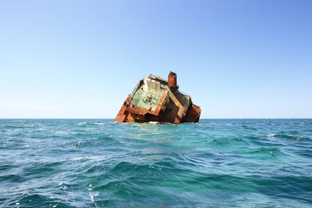wrecked ship Ibrahim-Yakim at cape tarhankut, Crimea. The weather is clear, there are vawes at the sea. Stock Photo