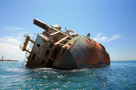 Stern of wrecked ship Ibrahim-Yakim at cape tarhankut, Crimea. The weather is clear, there are vawes at the sea.  写真素材