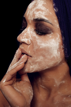 Beauty portrait of young mulatto fresh fashion woman in profile face in flour  milienkii photo