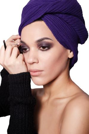 Makeup artist applies eye shadow. Beautiful woman face. Perfect  makiiazh photo
