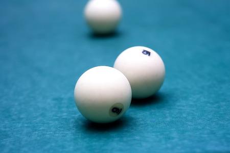 billiards halls: Billiard balls in a pool table sport Stock Photo