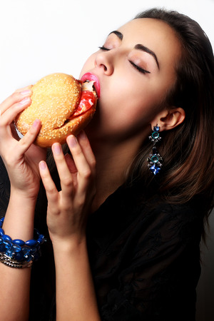 beautiful girl with hamburger on a white background