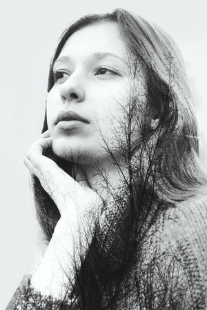 Double exposure of beautiful girl and leaves black and white tree Standard-Bild