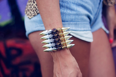 hot pants: bracelet on his hand A young girl in hot pants Stock Photo