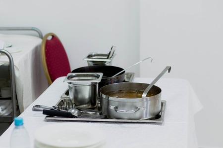 warmer: Close up stainless steel countertop food warmer and dish on table, catering concept Stock Photo