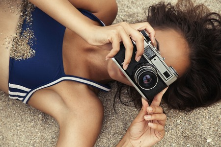 hot body: happy cute hot body young woman on the beach with colorful details, relax concept, travel