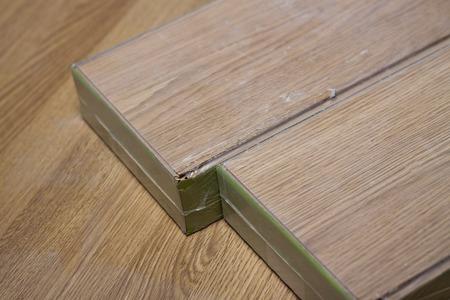 laminate flooring: laminate floor ready to flooring hammer, one, engine, caucasian, worker Stock Photo