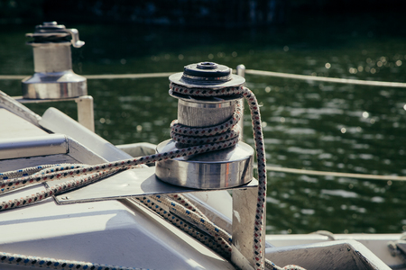 yachting: Sailboat winch and rope yacht detail. Yachting Stock Photo