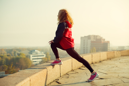 run out: Fitness woman runner relaxing after city running and working out outdoors