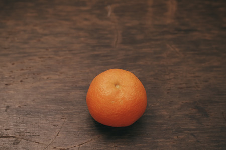 superficial: fresh mandarine on wooden surface processing