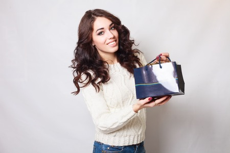 young  brunette: Beautiful smiling girl with gift bags