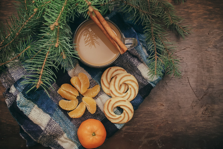 hristmas: Tangerines and cinnamon sticks, Christmas Tree Coffee on old wooden background