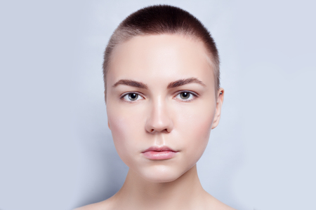 girl face close up: Beautiful Face of Young Woman bald, short hair with Clean Fresh Skin close up. Beauty Portrait. Beautiful Spa Woman Smiling. Perfect Fresh Skin. Pure Beauty Model. Youth and Skin Care Concept