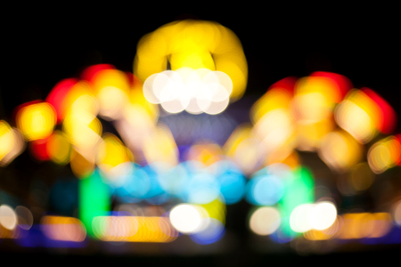 avocation: illuminated carousel blurred background, abstract bokeh, background