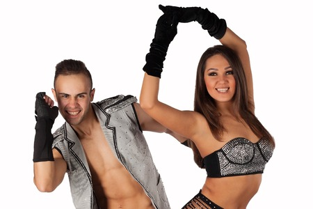go go dancer: Emotional young people in costumes dancing in studio. on a light background
