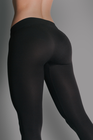 Woman in leggings and sneakers, low section. Sexy beautiful athletic ass . Beautiful athletic woman