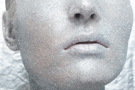 unreal: Beautiful, amazing portrait of woman. Unreal make up like a space. Closeup shooting in studio with silver background. Emotion, posing of model. silver glitter.