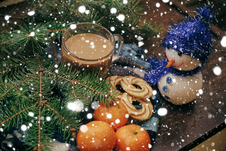 clementines: winter, christmas, food concept- Tangerines and cinnamon sticks, Christmas Tree Coffee on old wooden over snow background