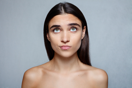 people, luxury and fashion, emotions concept - Portrait of young woman with shocked facial expression Stock Photo