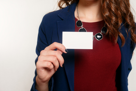 technologies, business, beauty and lifestyle concept - Young businesswoman showing her blank business card