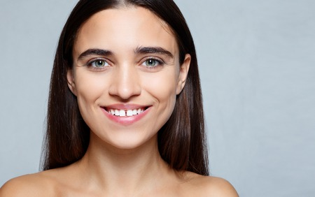people, luxury and fashion, emotions concept - The young womans portrait with happy emotions, smile , Closeup of beautiful brunette woman with pretty eyes and gap between teeth Stock Photo