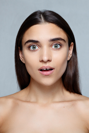 people, luxury and fashion, emotions concept - Portrait of young woman with shocked facial expression, Closeup of beautiful brunette woman with pretty eyes and gap between teeth