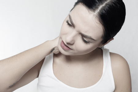 Tired Neck. Beautiful Young Woman Suffering From Neck Pain