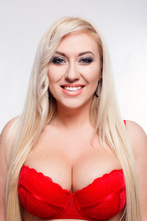 people,beauty, lifestyle, fashion and beauty concept -Portrait of young sexy woman in red bra