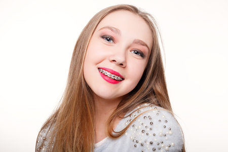 teeth,emotions, health, people, dentist and lifestyle concept - Healthy, beautiful smile, the child to the dentist.Portrait of a little girl with orthodontic appliance .