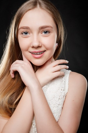 health, people, youth, dental and beauty concept - Portrait of teen girl showing dental braces. Stock Photo