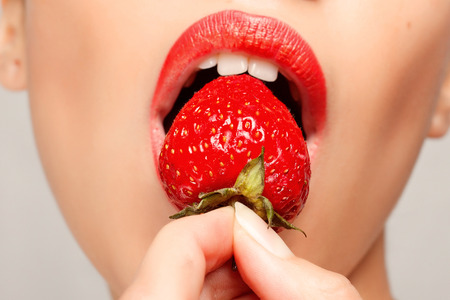 Sexy Woman Eating Strawberry.