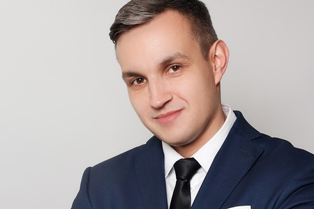 business, health, people, and lifestyle concept - Portrait of handsome man in black blue suit. close up portrait of young happy smiling cheerful young man 免版税图像