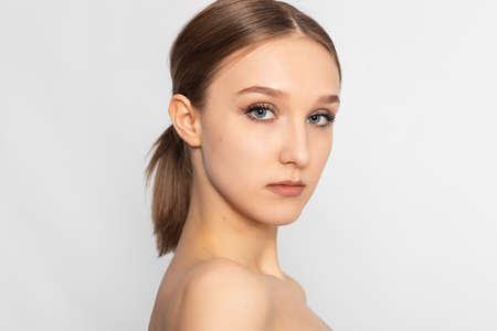 Beautiful Young Woman with Clean Fresh Skin look away. Girl beauty face care. Facial treatment. Cosmetology, beauty and spa. Stock Photo