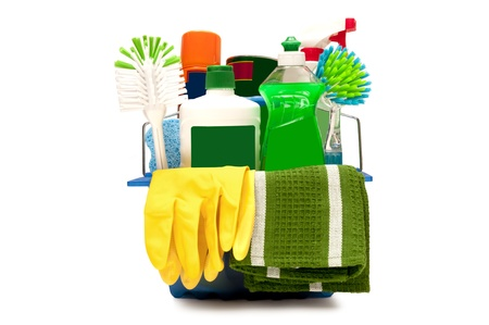 Very colorful shot of cleaning supplies with yellow rubber gloves and green cleaning cloth hanging on the outside    Isolated on white