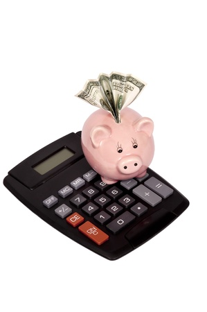 Vertical shot of calculator with piggy bank and hundred dollar bill in slot  Isolated on white Stock Photo - 17109502