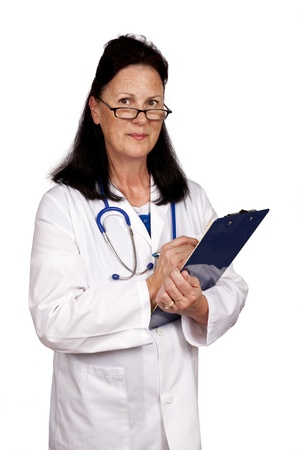 A friendly mature female doctor checks her clipboard