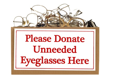 unneeded: Box full of unneeded glasses ready for donation   Isolated on white   Studio shot   Horizontal shot