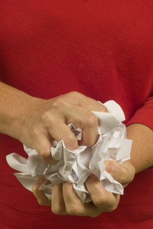 often: Often when people frustrated, stressed and angry they crumple paper   Here, a female is fed up and stressed   Plans are not going well